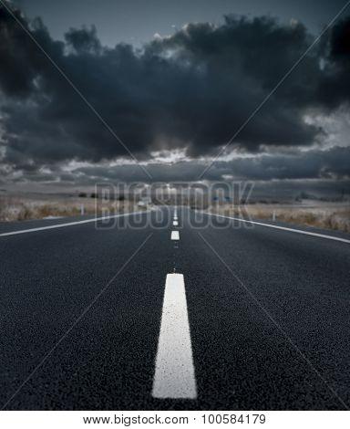 Asphalt road and the storm