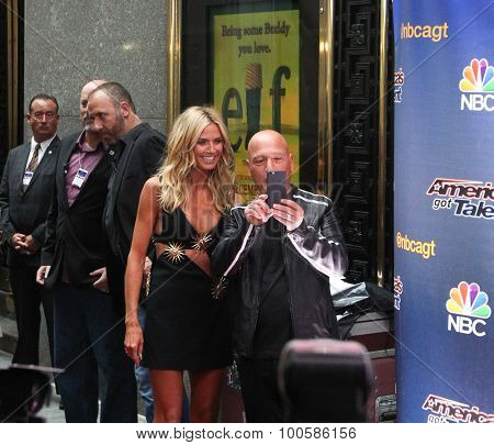 NEW YORK-AUG 11: Model Heidi Klum (L) and Howie Mandel attend the 'America's Got Talent' season 10 taping at Radio City Music Hall on August 11, 2015 in New York City.