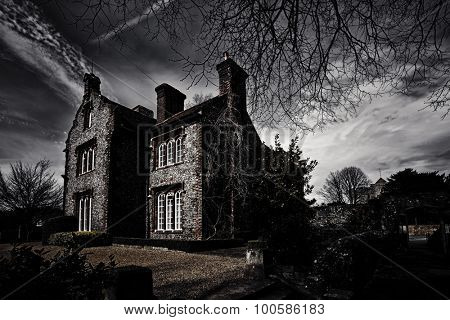 Old hunted building at midnight