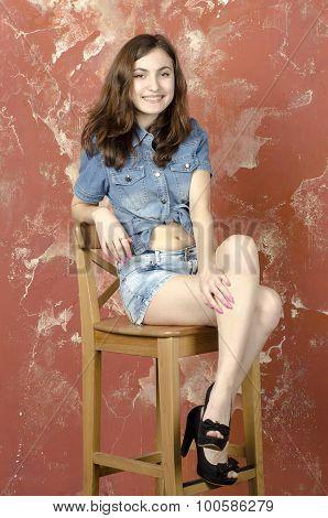 Cheerful young teen girl in denim shorts