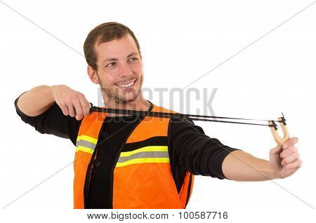 Handsome man concentrated aiming a slingshot with security vest isolated over white background
