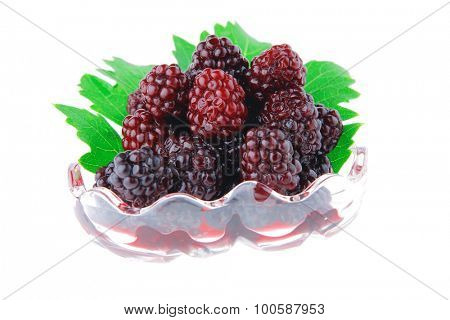 wild berry in small transparent bowl over white