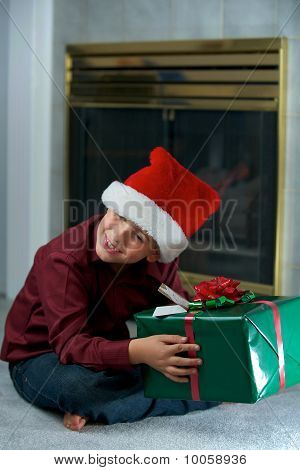 Boy In Santa Hat With Gift