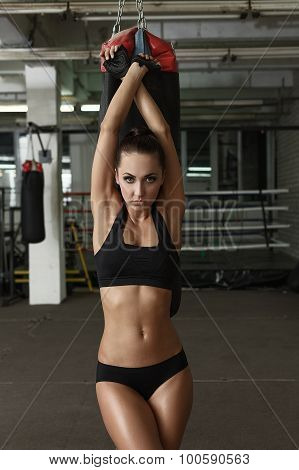 Image of harmonous tanned woman posing in gym