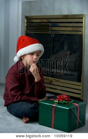 Boy Thinking About Present