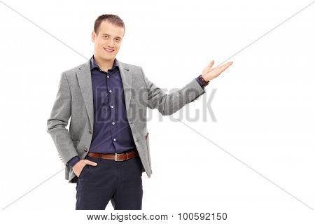Confident young man gesturing with his hand isolated on white background
