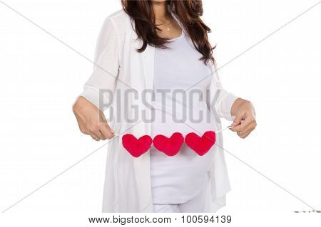 Asian Pregnant Woman Posing With Heart Shape Accessories On Her Tummy, Close Up