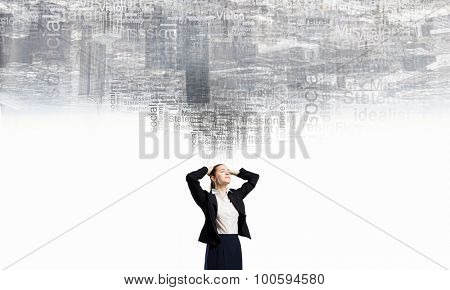 Young businesswoman with hands on head thinking something over