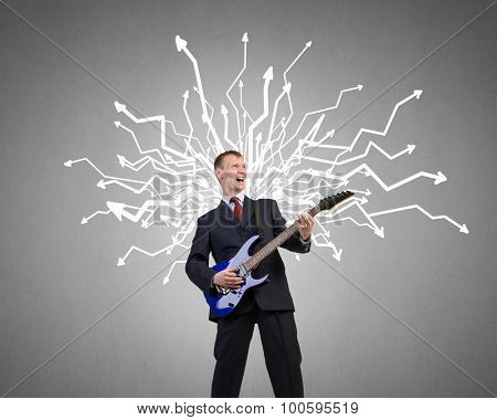Young man in black suit playing electric guitar