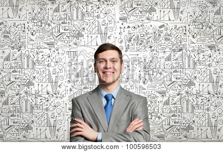 Happy businessman with arms crossed on the chest