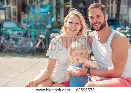 Portrait of a happy family enjoying morning in Amsterdam, capital of the Netherlands