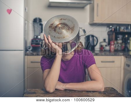 Concerned Woman With Pot On Her Head