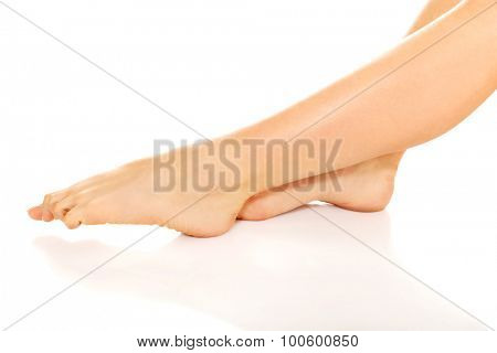 Young naked woman legs,isolated on white.