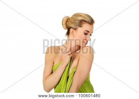 Young woman after bath iin green towel, isolated  on white.