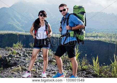 Young Woman And Man Go Trekking Together, Nature Background