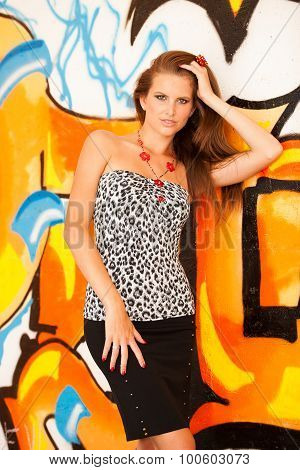 Fashionable Woman With Blured Graffitti In Background
