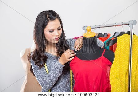 Fashion Designer Or Tailor Working On A Design Or Draft