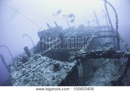 Divers On A Deep Underwater Shipwreck