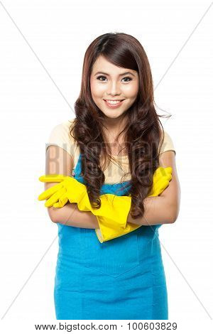 Young Asian Woman Getting Ready To Do The Chores, Putting On Yellow Latex Gloves