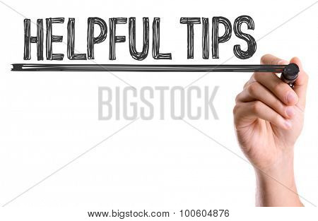 Hand with marker writing the word Helpful Tips