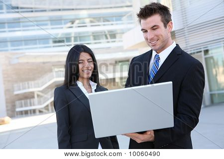 Business Team With Laptop (focus On Man)