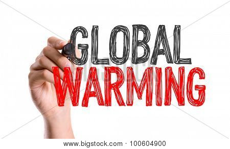 Hand with marker writing the word Global Warming