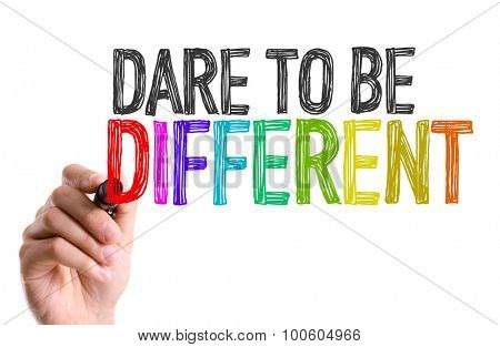 Hand with marker writing the word Dare To Be Different
