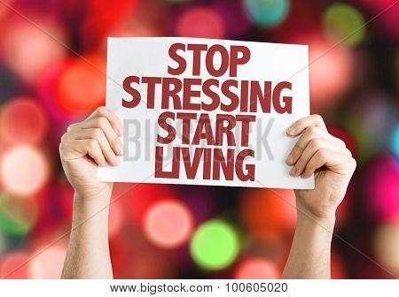 Stop Stressing Start Living placard with bokeh background