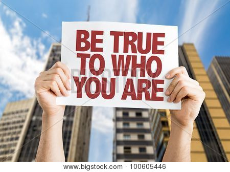 Be True To Who You Are placard with cityscape background