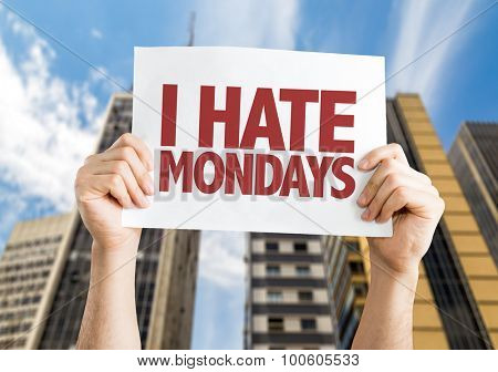 I Hate Mondays placard with cityscape background