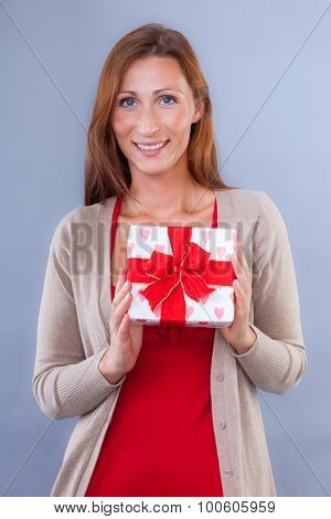 female holding gift