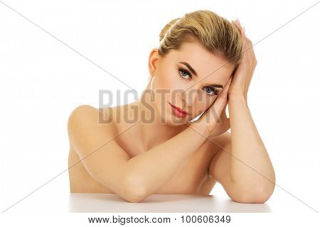 Young naked relaxed woman, isolated on white