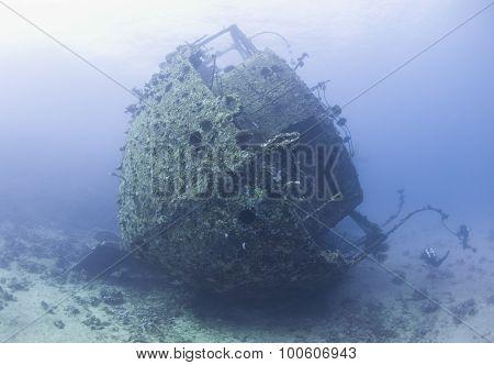 Diver Exploring A Large Shipwreck