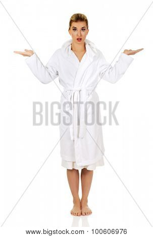 Young surprised woman after bath holding something, isolated on white