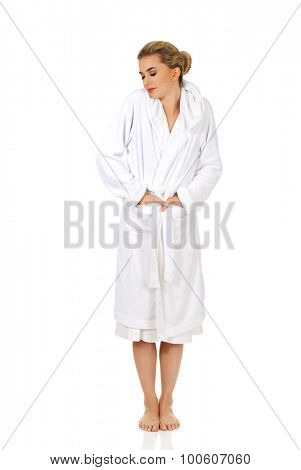 Young beautiful caucasian woman after bath,isolated on white.