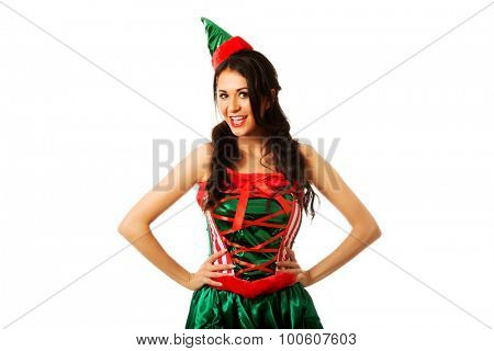 Smiling woman wearing elf costume.