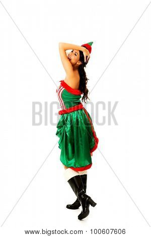Slim woman wearing elf clothes holding her head