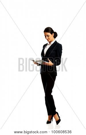 Beautiful businesswoman reading her notes.