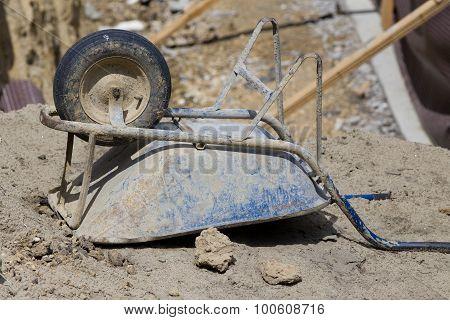 Wheelbarrow At Building Site