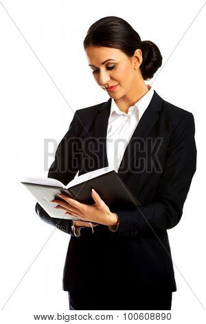 Pensive businesswoman reading her notes.