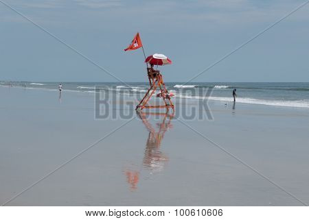 JACKSONVILLE BEACH, FL-AUGUST 28, 2015: A lifeguard watches over Jacksonville Beach, Florida. The Jacksonville Beach Lifeguards began in the summer of 1912 with a dozen volunteers.