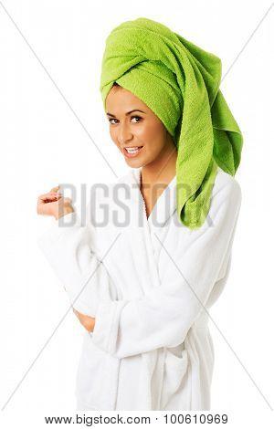 Spa woman in bathrobe looking at camera.