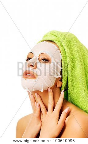 Spa woman with revitality face mask.