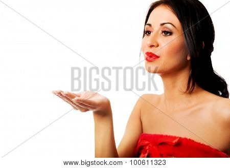 Beautiful woman wearing elf clothes blowing kiss.