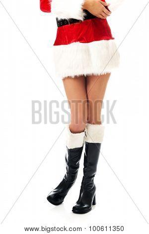 Female slim legs in santa high boots