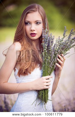 Beautiful Young Woman On Lavender Field