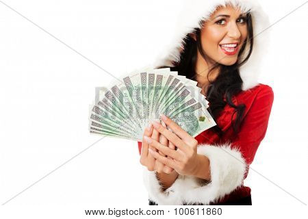 Woman in santa clothes holding a clip of polish money.