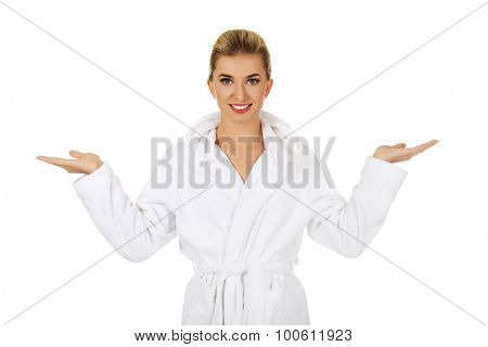 Young happy woman after bath holding somathing,isolated on white.