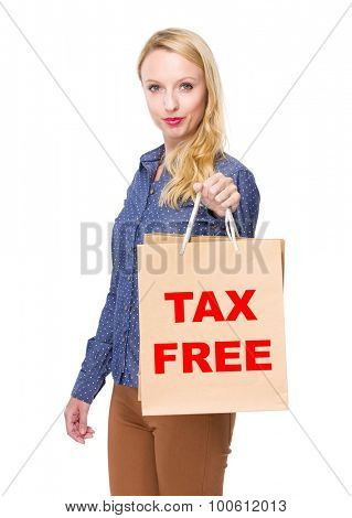 Woman with shopping bag and showing phrase of tax free