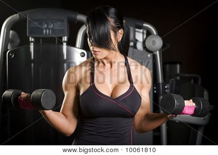 Muscular Asian Woman Working Out With Weights